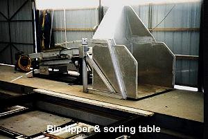 Bin tipper and sorting table.